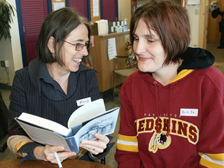 Image of author with adult education student