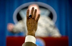 Image of reporter with a raised hand