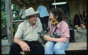 Image of two people talking on a porch