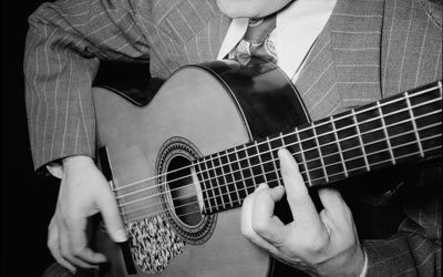 Image of hands with guitar