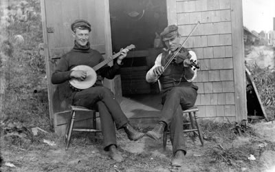 Image of men playing banjo and fiddle