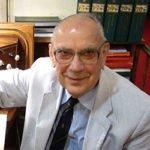 William Tortolano sitting at an organ
