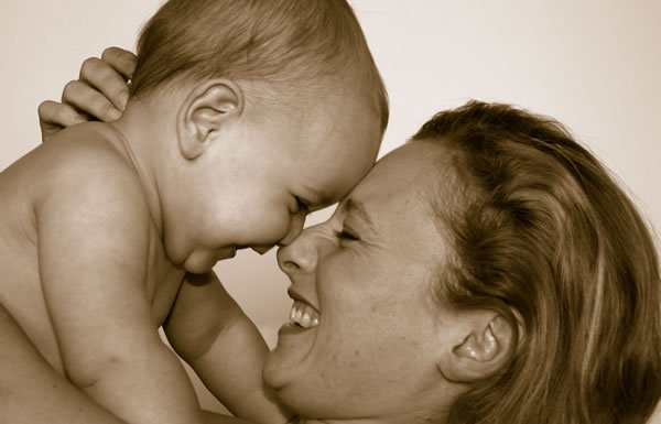 Image of mother laughing with baby