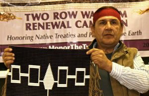 Image of Native American man with traditional artwork