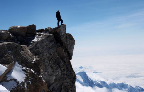 Image of hiker at top of mountain