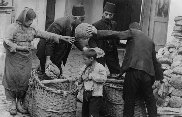 Armenian_refugee_women_and_child_getting_food_relief-web