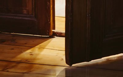 Image of wooden door opening