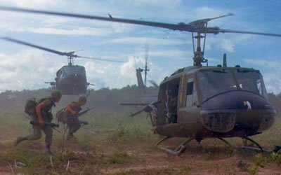Image of soldiers running to helicopter