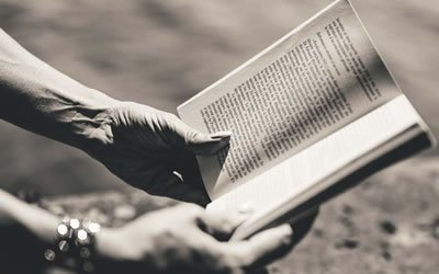 Image of hands with book