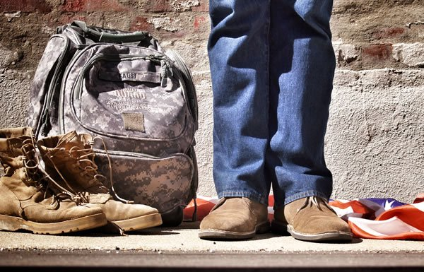 Image of solider with backpack and bag