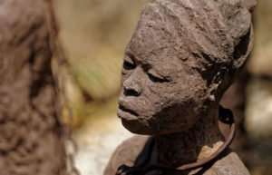 Image of woman covered in mud