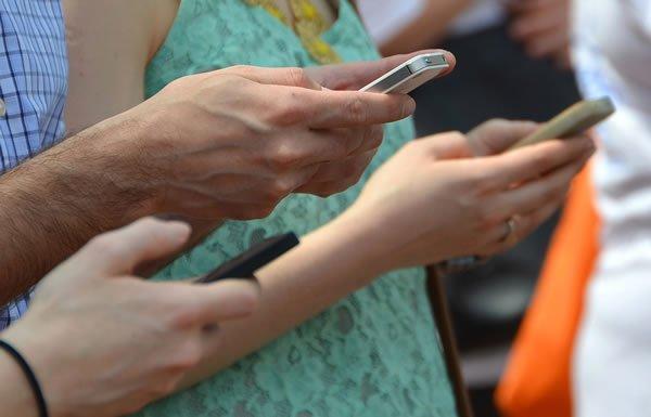 Image of hands holding smartphones