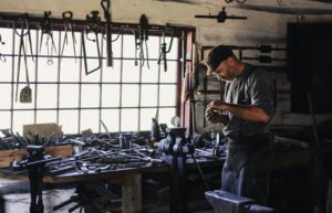 Image of craftsman at workbench