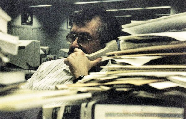 Image of reporter on the phone