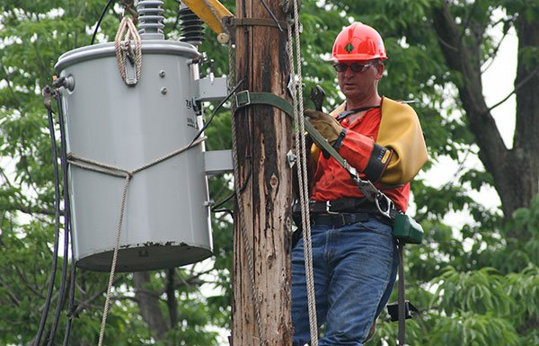 Image of lineman on electrical pole