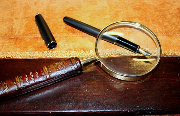 Image of magnifying glass and pen