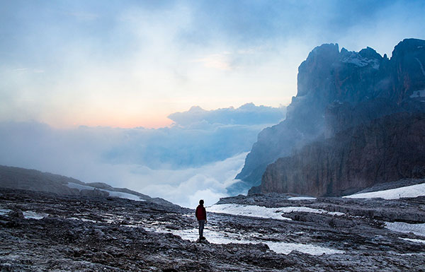 Image of man with clouds and mountains