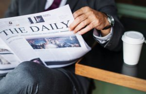Image of man reading newspaper