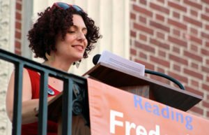 Image of woman reading at Douglass event in Burlington