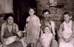 Image of family in rough cabin