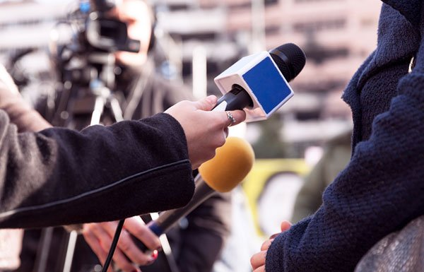 Image of female reporter holding microphone