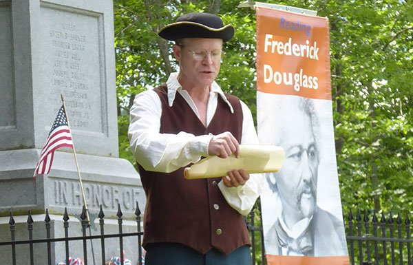 Image of man in colonial garb reading speech