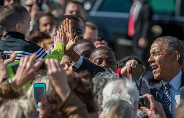 Image of President Obama giving boy high five