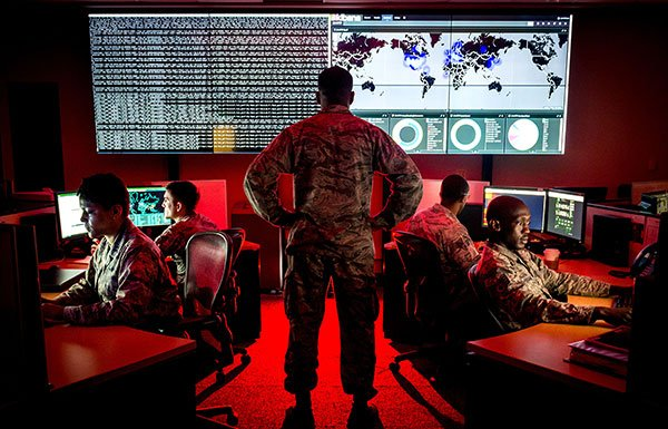 Image of solider looking at computer screens