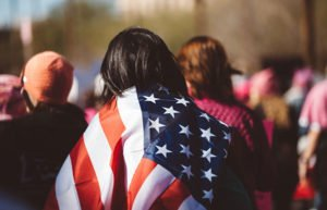 Image of woman wrapped in American flag