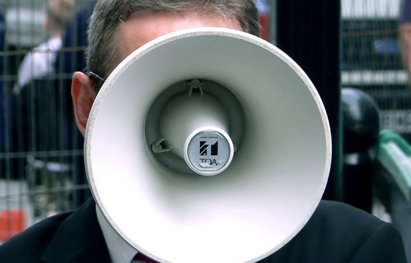 Image of man with bullhorn
