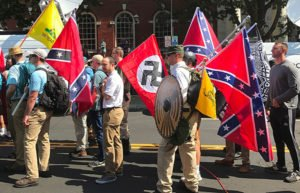 Image of white supremacists with flag