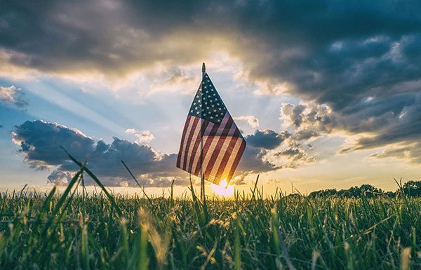 Image of American flag with sunset