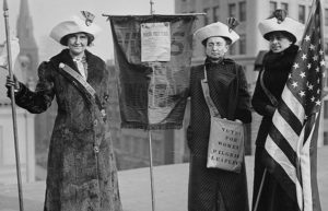 Image of women with flags and voting signs