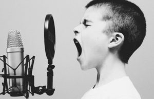 Image of child shouting into a microphone