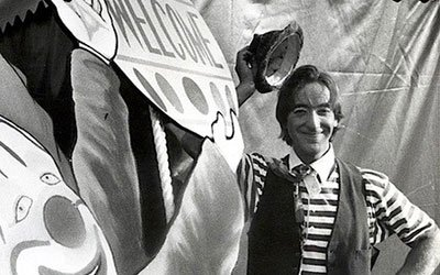 Image of man with painting of a clown