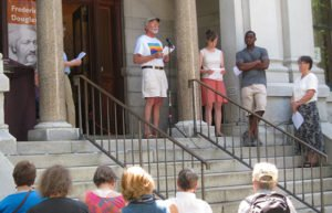 People reading speech outside of Kellogg-Hubbard Library