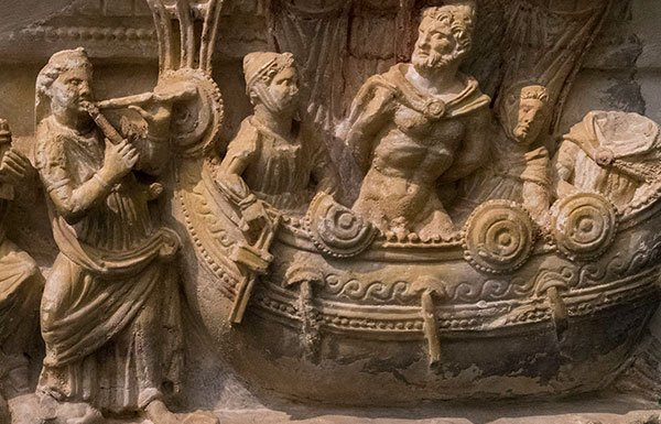 Stone carving of men in boat