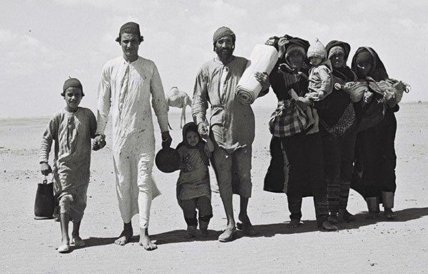 Group of peddlers in desert
