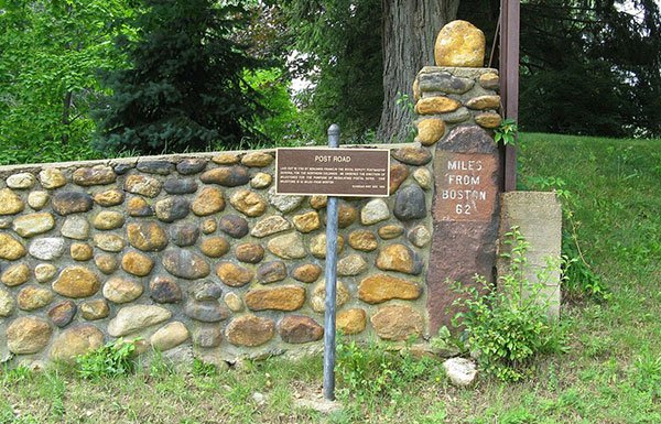 Stone wall with park sign