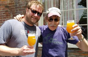 Bill Mares and friend with beer