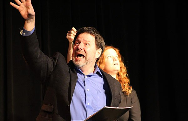 Two actors on a stage