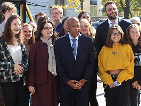 John Lewis and Andrew Aydin with a group of students