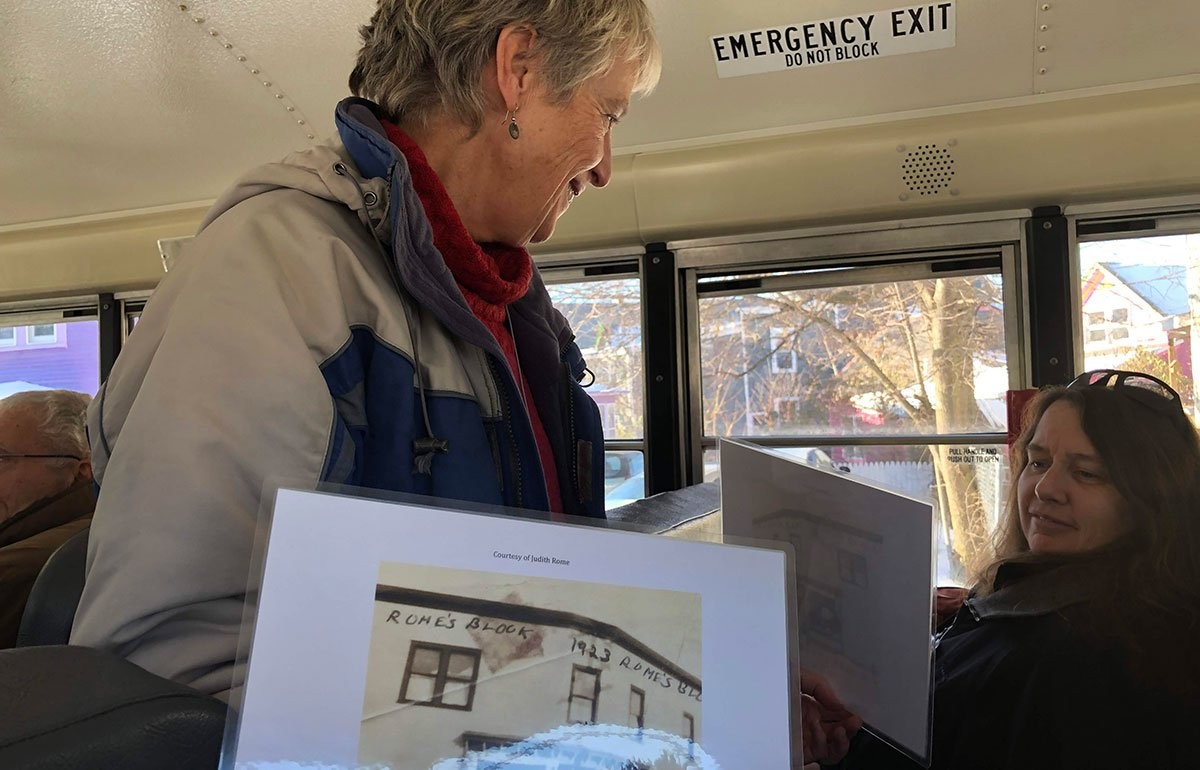 Elise Guyette showing image on schoolbus