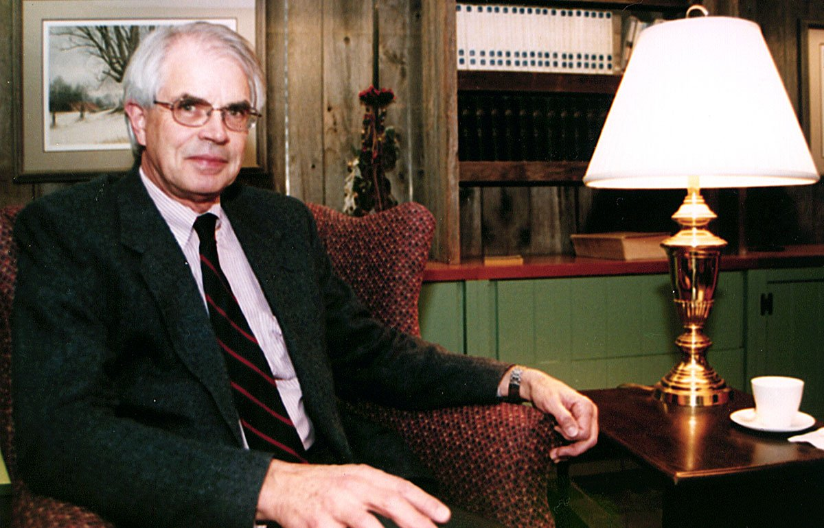 Victor Swenson in chair beside lamp