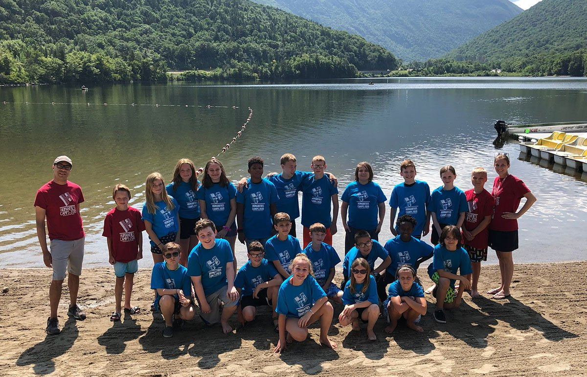 Humanities campers and staff in front of lake