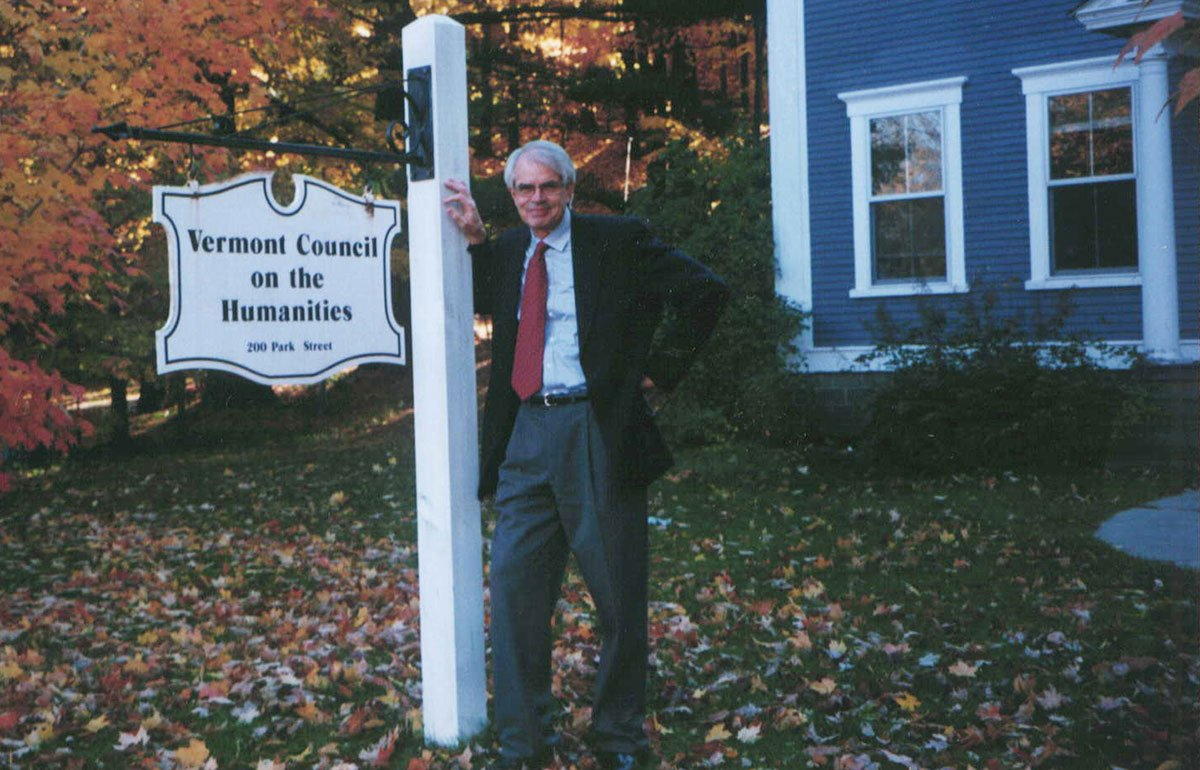 Victor R. Swenson in front of old Humanities Council building