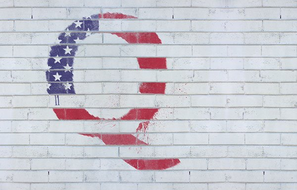 Q with American flag background painted on white brick wall