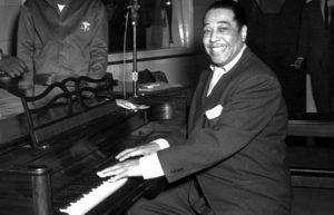 Duke Ellington smiling at the piano
