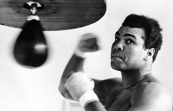 Muhammad Ali with a speed bag
