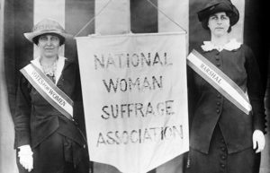 Two women with National Suffrage Association banner
